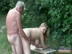 Oldman with young girl outdoor