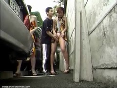Asian Teens on Outdoor street parking